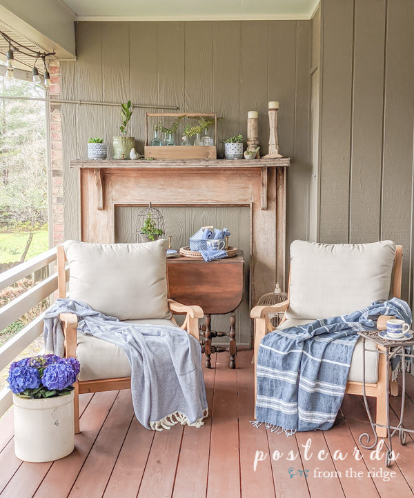 spring deck decor with teak chairs and blue and white accents