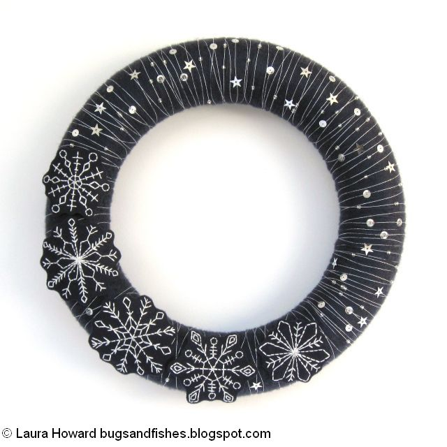 wreath decorated with beads and sequins and silver thread