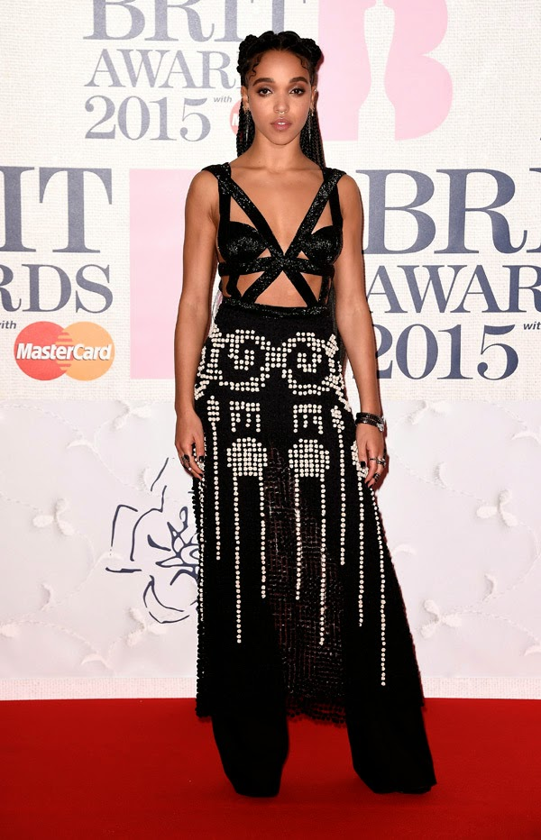 FKA twigs flashes skin in an Alexander McQueen ensemble at the 2015 BRIT Awards in London