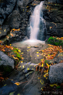 Cramer Imaging's fine art landscape photograph of mini waterfall and pool with fallen autumn leaves