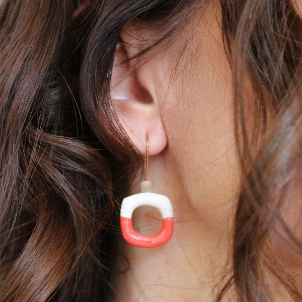 open hoop copper and paper mache earring on model
