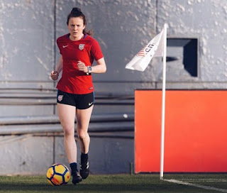 Picture of Rose Lavelle training football