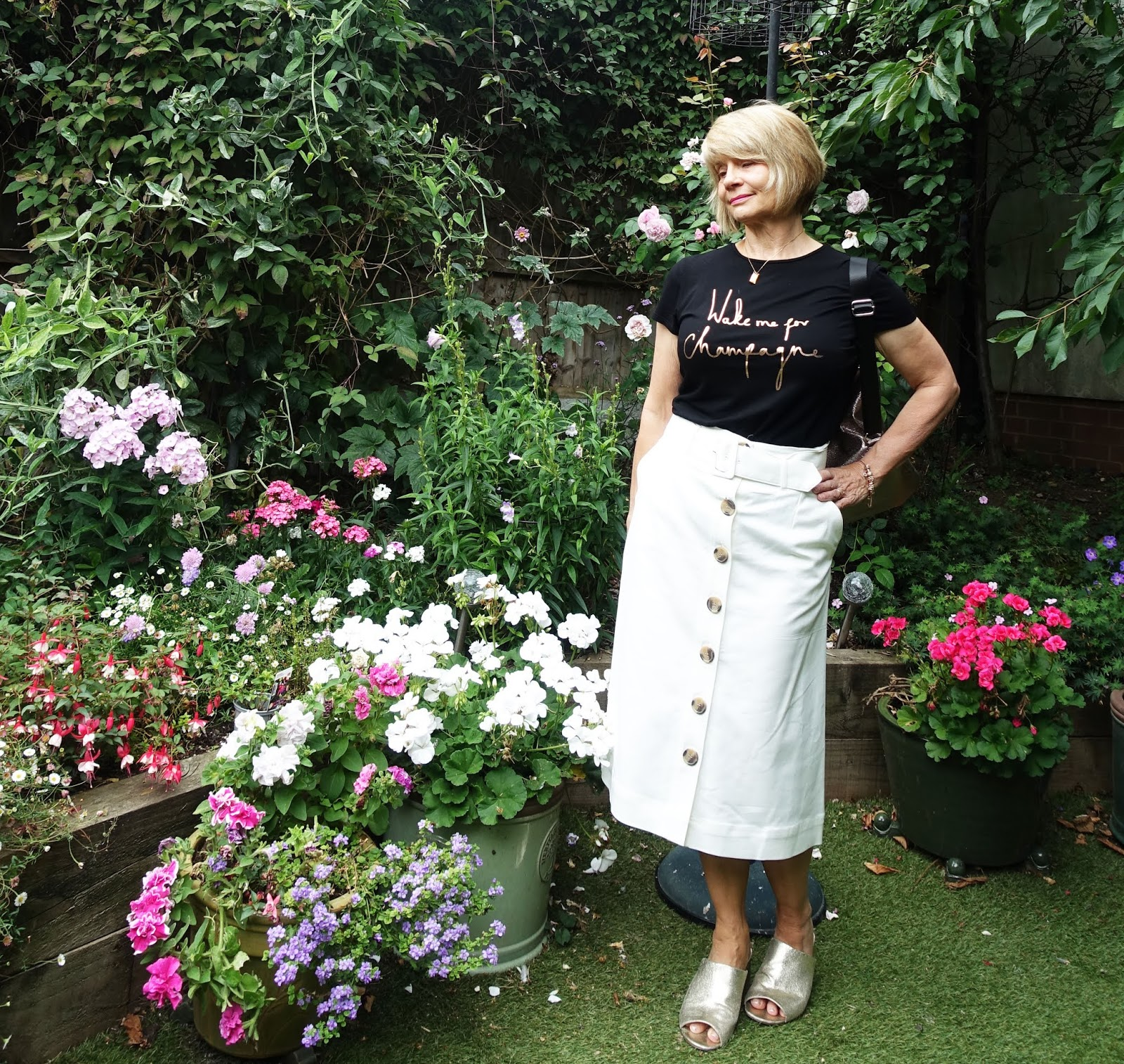 Over 50s style blogger Gail Hanlon from Is This Mutton recommends snapping up items of clothing in different colours and sizes if you find something timeless that suits you.  She has this white skirt from Marks and Spencer in three colors and the top from Ted Baker in two.