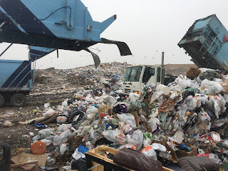 Photo of a garbage truck dumping garbage into a dump. Garbage dump. https://trimazing.com/