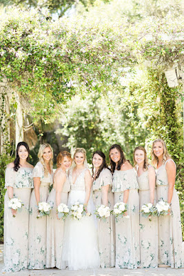 bridesmaids in flower dresses with bride