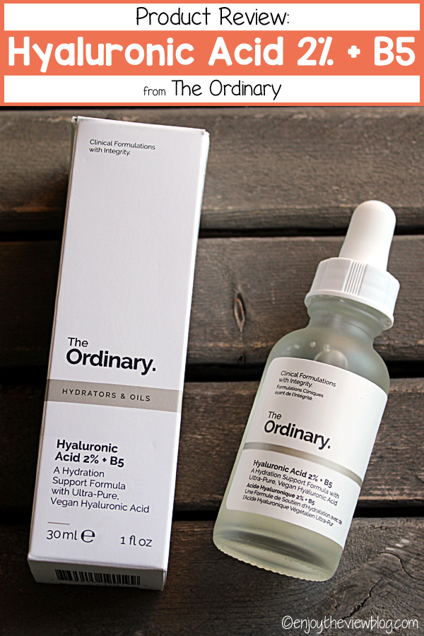 "A pinnable image of the Hyaluronic Acid 2% + B5 from The Ordinary with the bottle lying on a table next to the product box and a text box above that says ""Product Review: Hyaluronic Acid 2% + B5 - The Ordinary"""