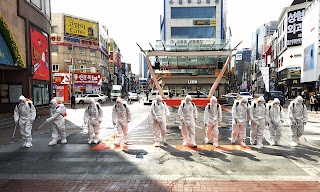 Coronanvirus outbreak: troops spray disinfectant in Daegu, a stronghold of the Shincheonji church linked to many cases in South Korea. Photograph: Lee Moo-ryul/AP