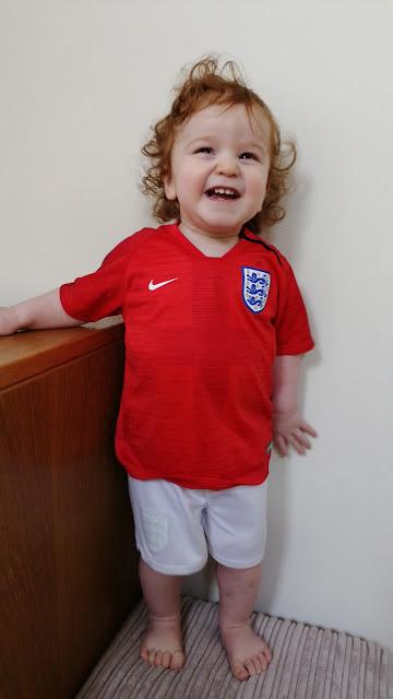 Mini posing in his England kit