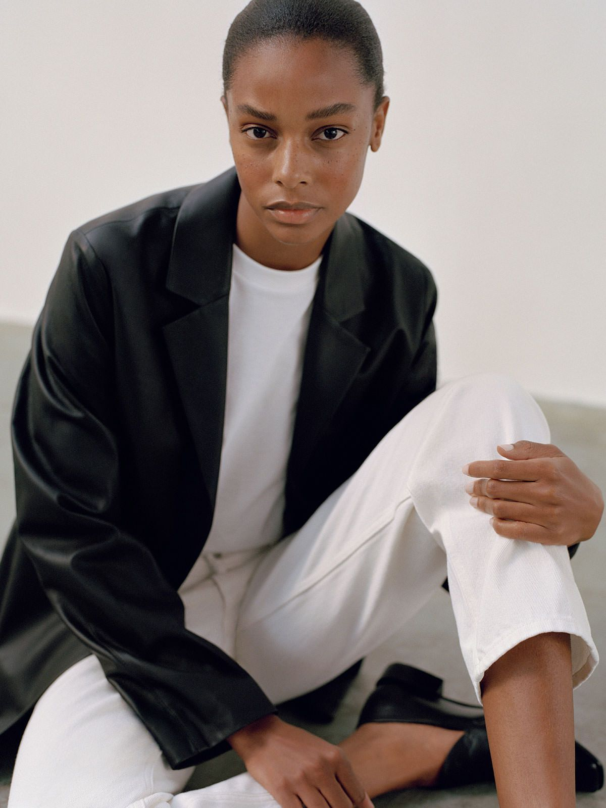5 Minimalist Fall Outfit Ideas — Capsule Wardrobe with black leather jacket, white t-shirt, and white jeans