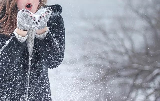 girl with black dress with ice snow