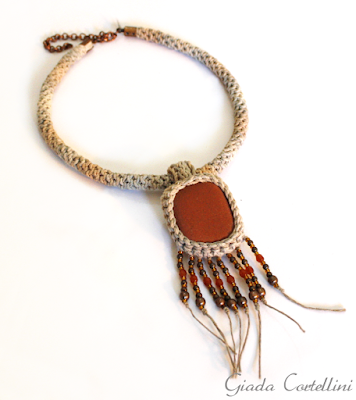 https://www.etsy.com/listing/504030036/tribal-necklace-hemp-necklacesea-stone?ref=shop_home_feat_1