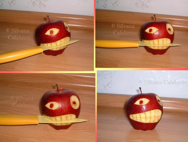 Carvings. Apple that bites knife