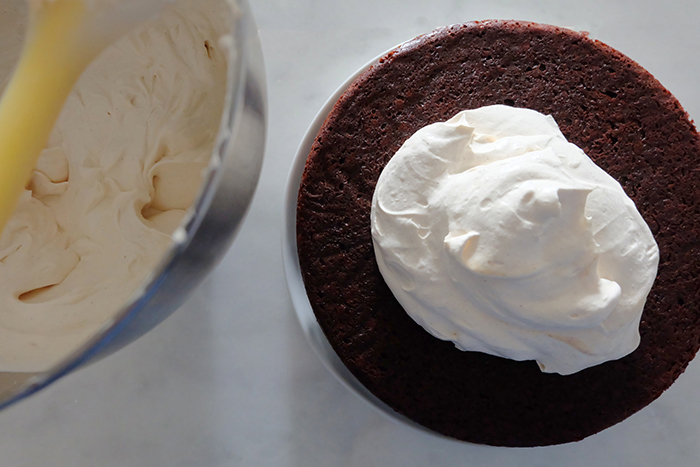 Mexican Chocolate Cake with Mascarpone Whipped Cream Frosting layer half