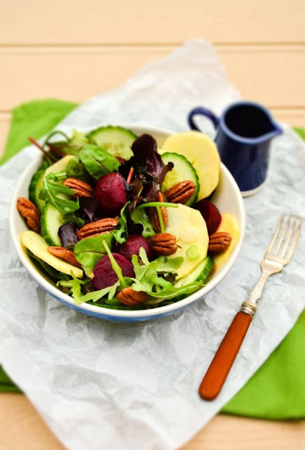 Apple, Beet and Pecan Salad with jug of honey and mustard dressing