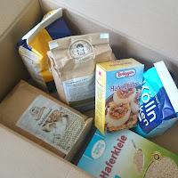 Paket mit Haferflocken und Haferprodukten - alleskörner