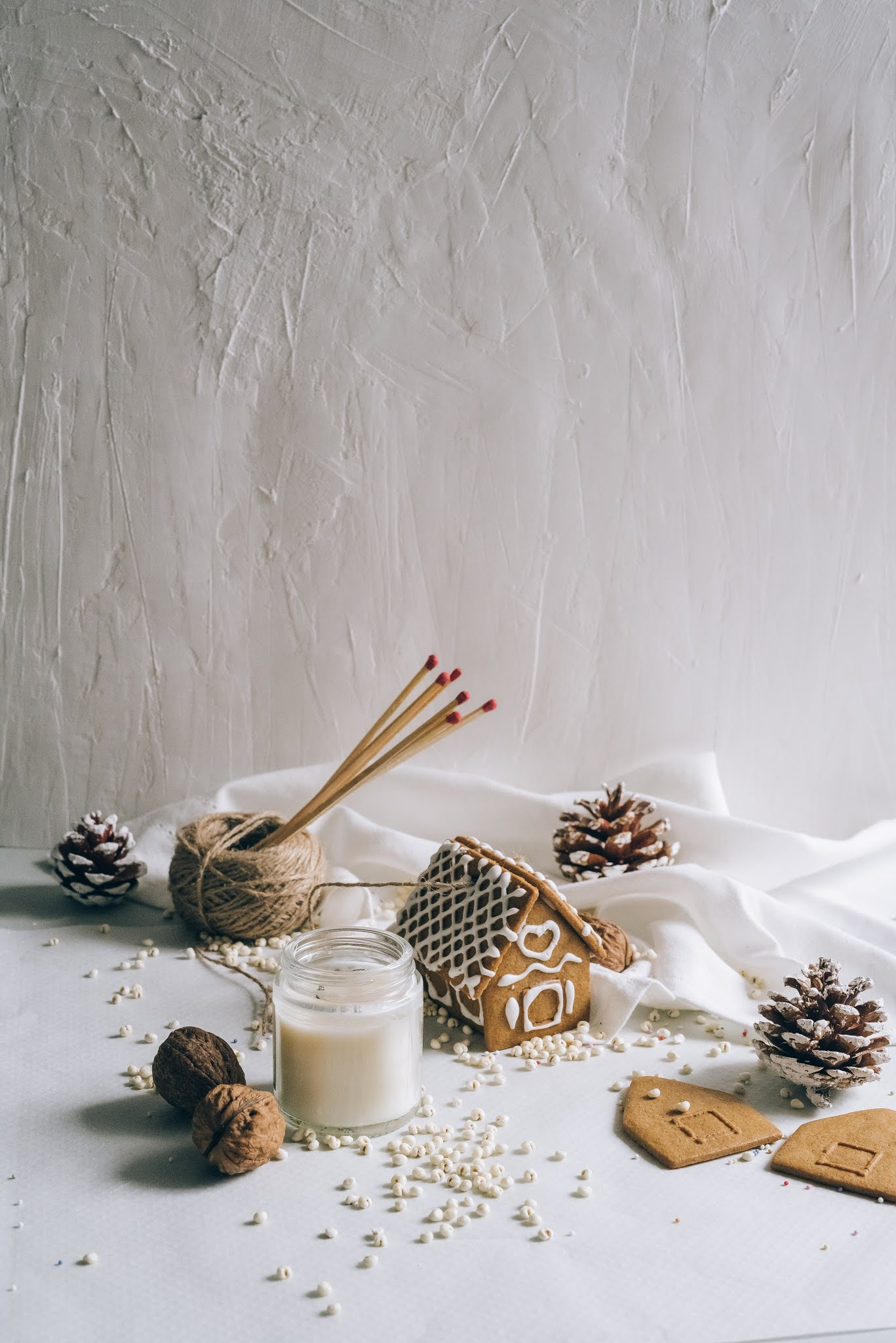 christmas decorations and gingerbread house on white background