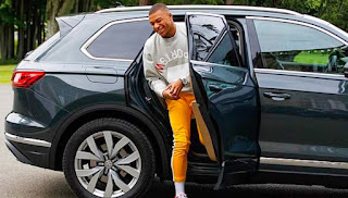 Wilfried's son Kylian Mbappe coming out of a car