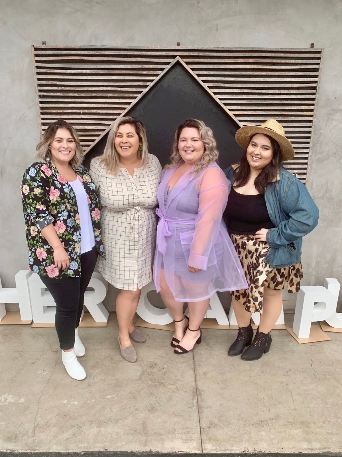 Chicago Plus Size Petite Fashion Blogger, YouTuber, and model Natalie Craig, of Natalie in the City, attends Her Campus' Her Conference and reviews Fashion Nova Curve's see-through mesh lilac lavender jacket.