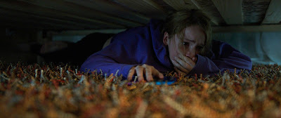 Talitha Eliana Bateman thinks she's safe under the bed in COUNTDOWN.