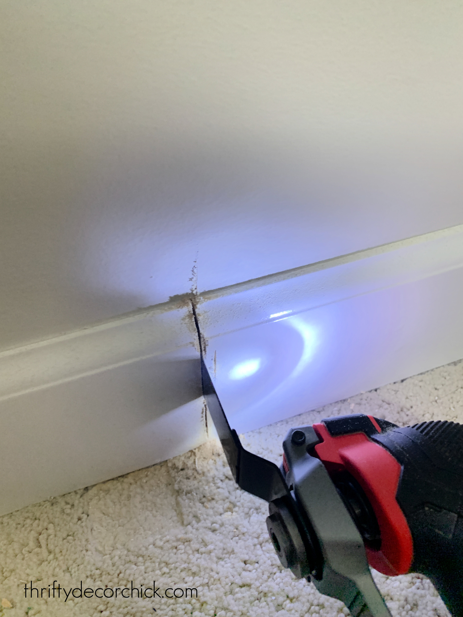 cutting baseboards with saw