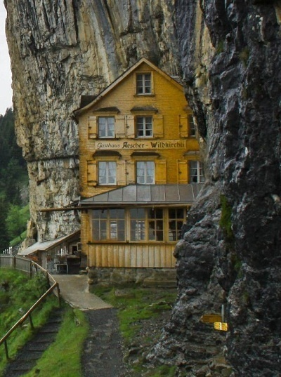 14 Crazy Hotels That Will Give You Serious Travel Goals - Äscher Cliff in Switzerland sits right on the edge of a steep cliff, a perfect getaway for travelers who like a little bit of riskiness (not to mention hiking) with their overnight stay.