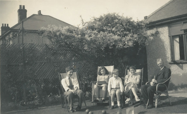 Osborne, Marion, Jackson, Aunty Jo and Fred House sitting on deckchairs in the garden