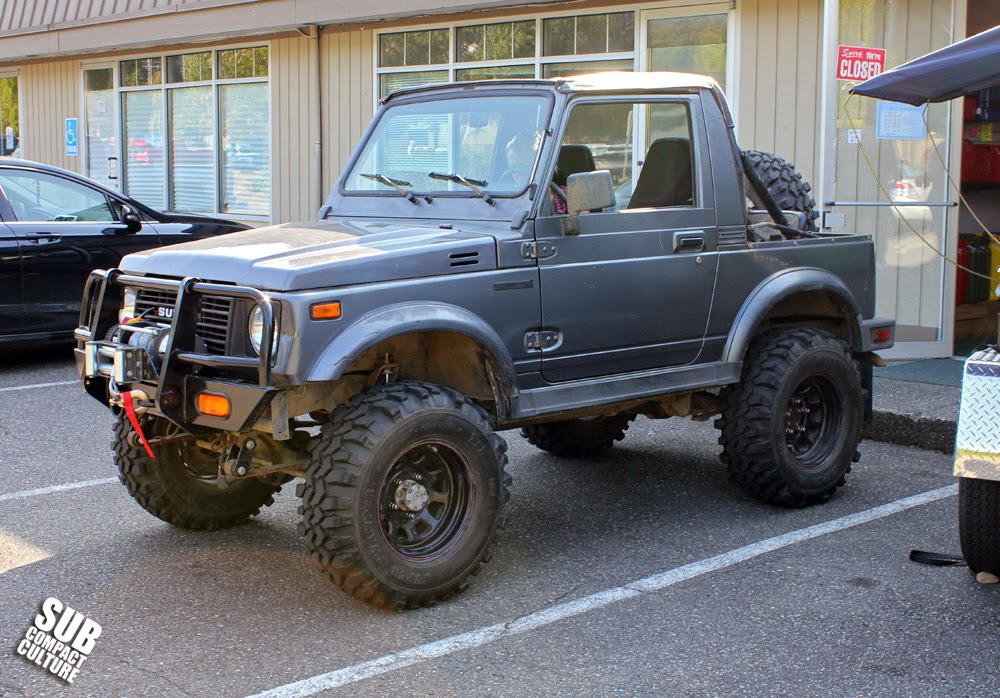 Lifted gray Suzuki Samurai