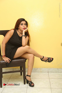 Tollywood Upcoming Actress Pooja Roshan Stills in Black Short Dress at Plus 1 Movie Trailer Launch  0316.JPG