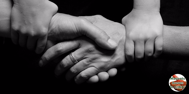 "Header image of the article: ""38 Words Of Encouragement And Strength For Tough Times"" - A selection of the best quotes and words of wisdom about encouragement and strength when things get hard in life. Hands holding each other, encouraging strength."