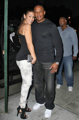 Rapper and music producer Dr. Dre (Andre Young) and his wife Nicole Threatt take a walk together.