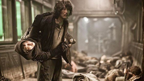 Ah-sung Ko and Kang-Ho Song in Snowpiercer