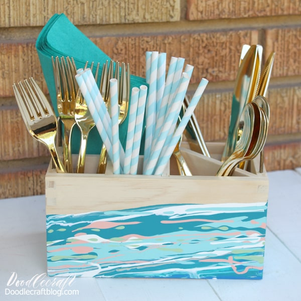 Acrylic Pouring Abstract Painting on Organizer Caddy DIY filled with gold utensils, paper straws and teal napkins