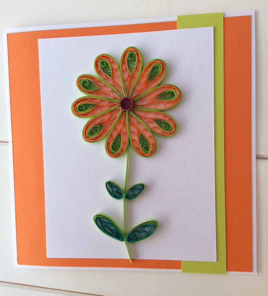 Elizabeth moad crafts beautiful a flower made by looping paper strips around a comb and combining traditional quilled shapes for the petals and leaves first seen in crafts beautiful mightylinksfo
