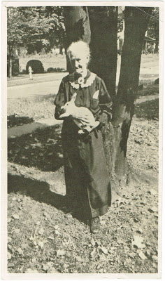 Aunt Cassie holding a rabbit in front of her home in Erwin TN circa 1940