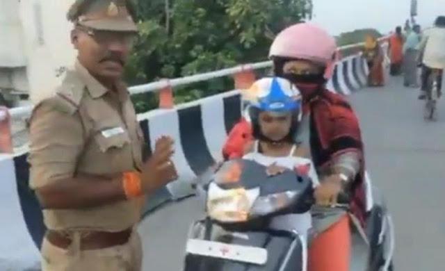 जब हेलमेट पहनने के बाद भी ट्रैफिक पुलिस ने मां-बेटी को रोका... - newsonfloor.com