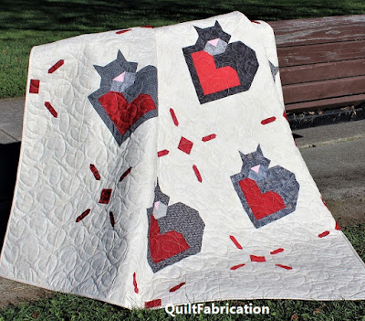 Wrap Up Some Love quilt by QuiltFabrication