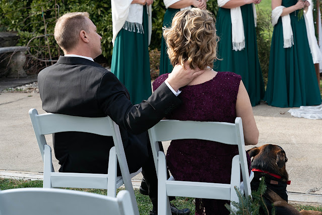 Parents of Married couple sitting together during the ceremony Magnolia Farm Asheville Wedding Photography captured by Houghton Photography