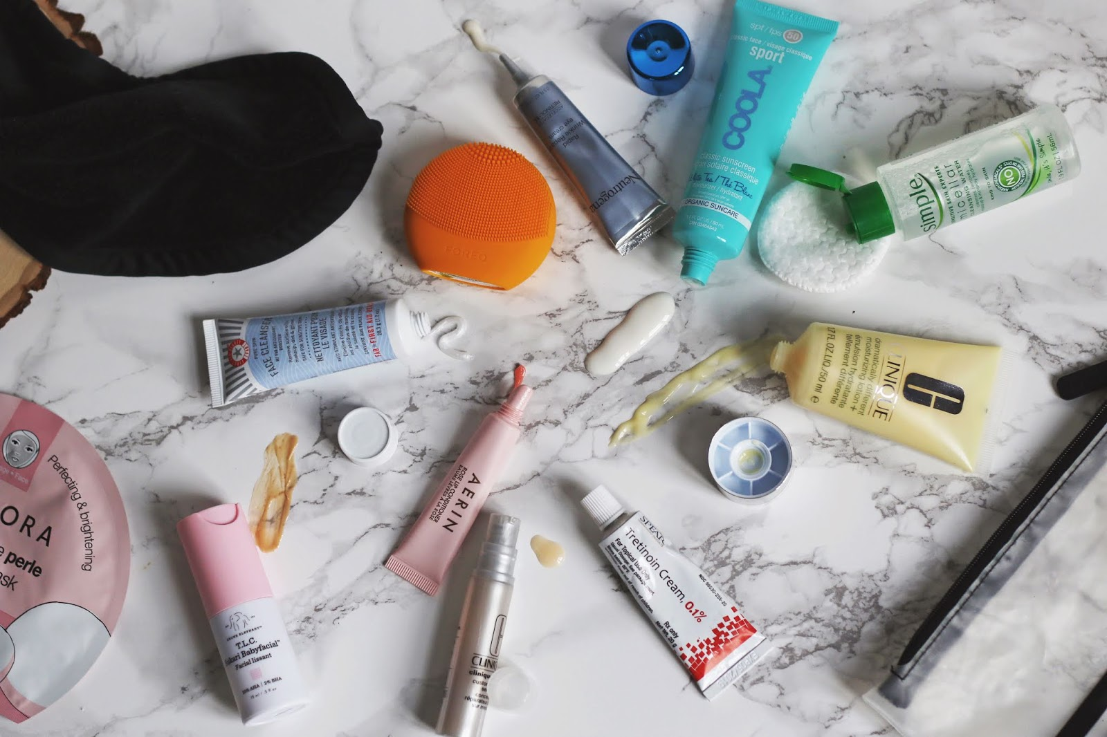 Take care of your skin when traveling, what to pack for skincare when traveling, travel sized skincare, mini skincare products, Drunk Elephant TLC Sukari Babyfacial, Sephora Collection Face Masks, Clinique Moisturizer, First Aid Beauty Cleanser, Foreo, Aerin Rose Lip Conditioner, Cotton Rounds, Simple Micellar Water