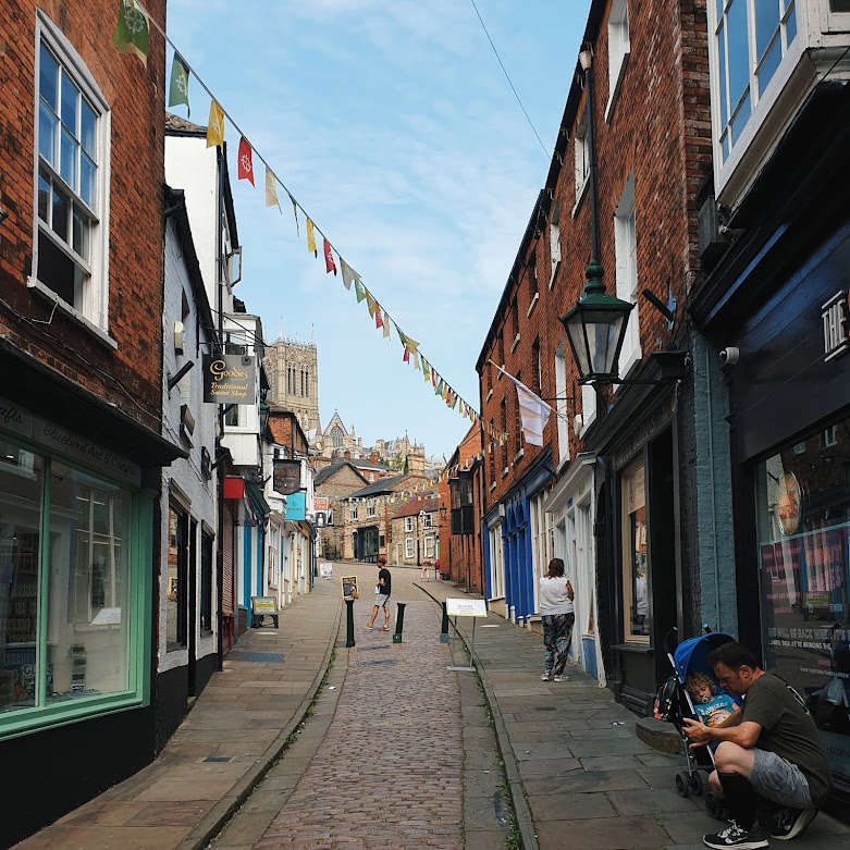 lincoln steep hill, market town, independent shops, flags and bunting, cobbled streets