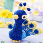 http://www.topcrochetpatterns.com/images/uploads/pattern/Prince_the_peacock_by_Janine_Holmes.pdf