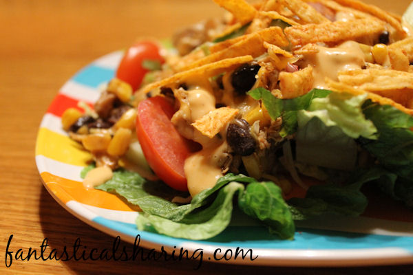 Chicken Enchilada Salad |  No need to eat a boring old salad - this salad has seasoned chicken, corn, black beans, and more! #recipe #salad #chicken