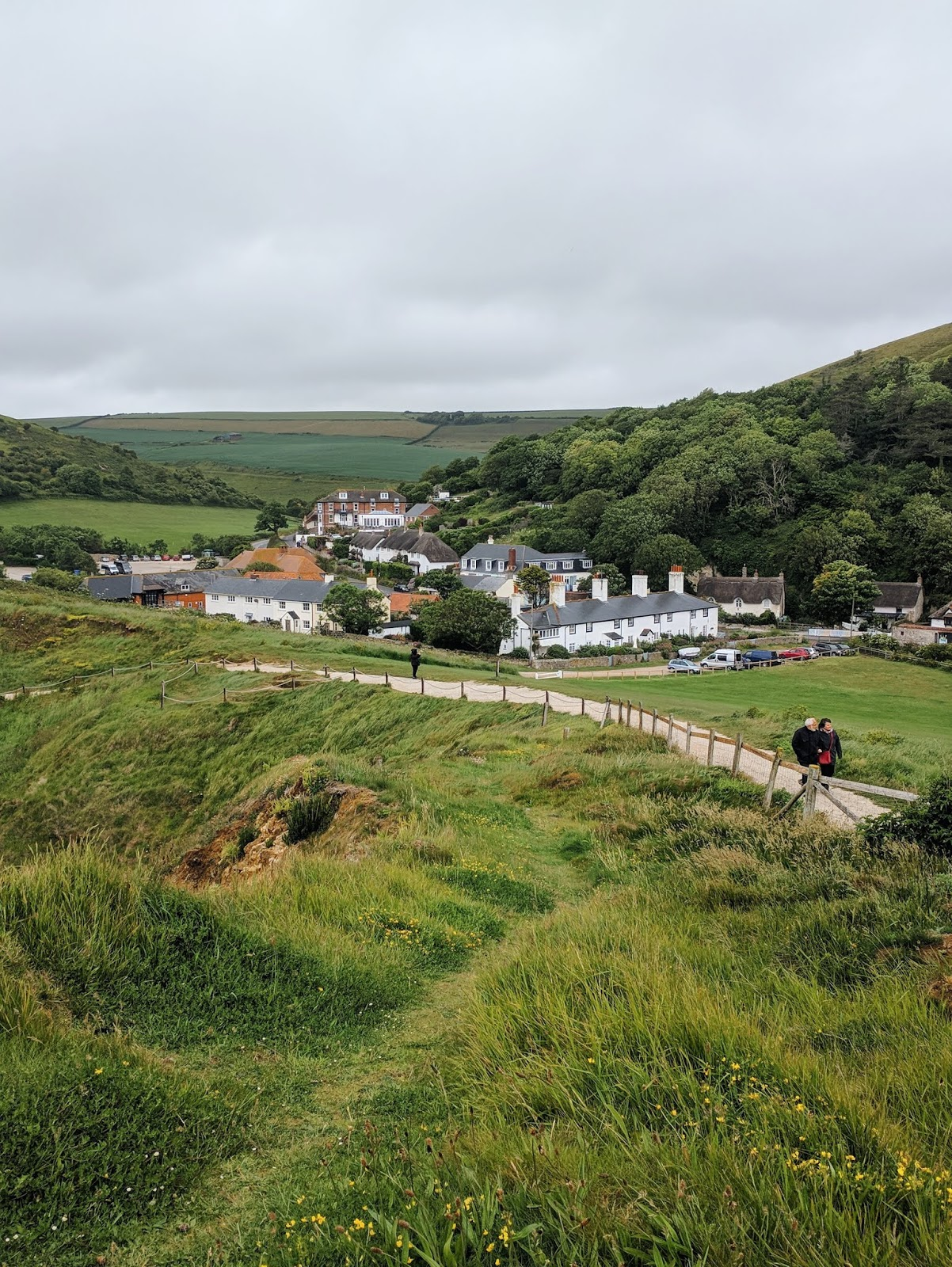 the charming town with white and brick houses by Lulworth Cove
