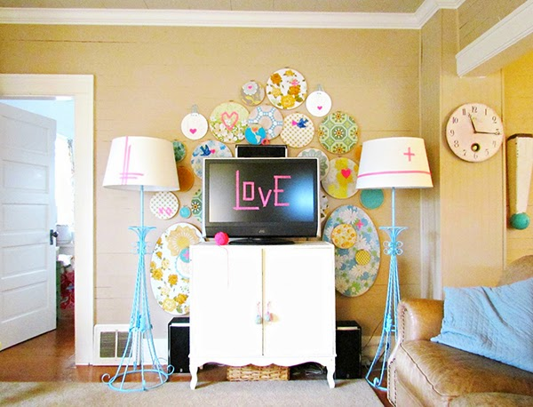 Embroidery hoop fabric wall art behind the tv - a GREAT idea!
