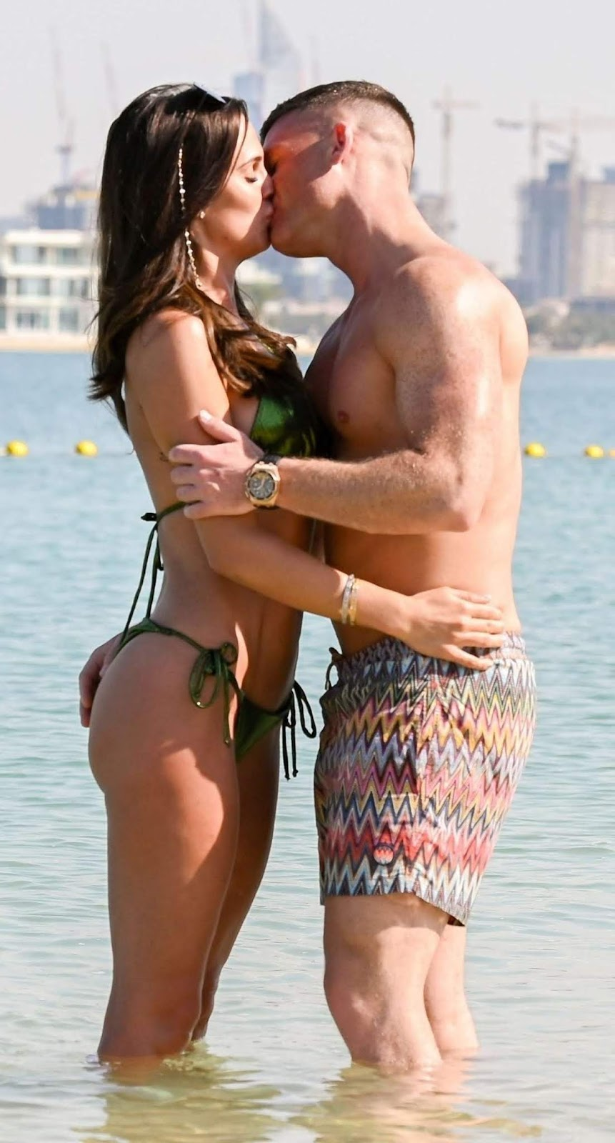 Danielle Lloyd displays the fruits of her surgeon's labour while getting steamy with husband Michael O'Neill in Dubai... after undergoing a boob job, liposuction and a bum lift