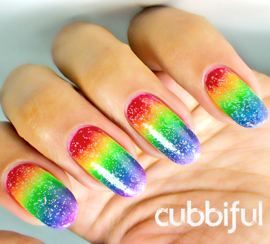 Fairy dust over rainbow nails