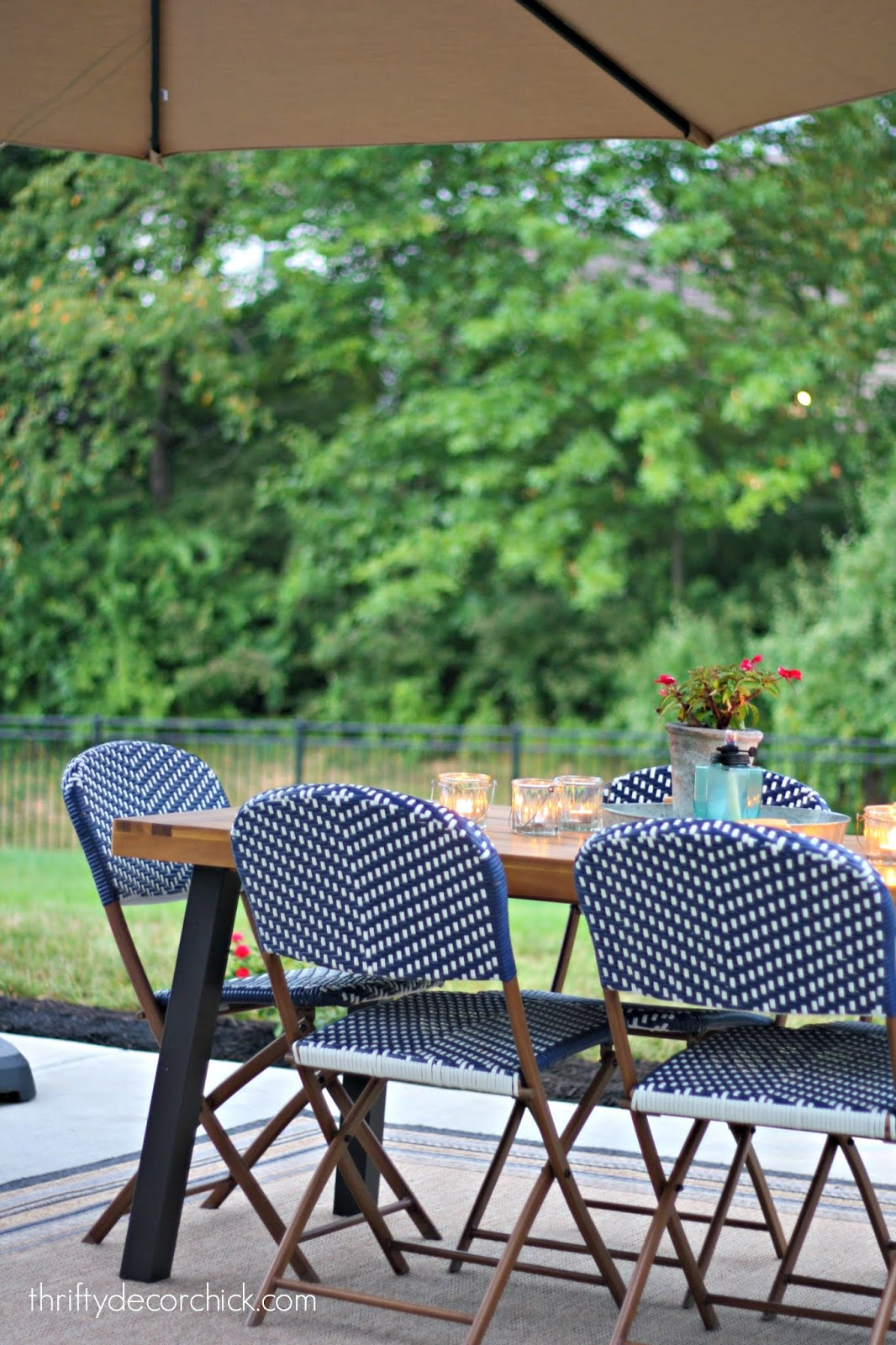 Plastic wicker patio chairs in blue and white