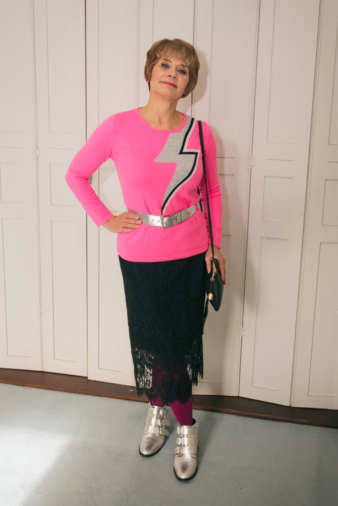 Image showing an over 40s blogger in pink Bowie sweater and black lace skirt with silver boots