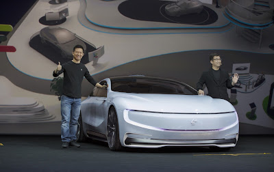 Source: LeEco. Jia Yueting (left) and Ding Lei demonstrate the self-driving functions of the LeSEE concept car by using a Superphone to control the car remotely.