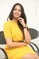 Actress Poojitha Stills in Yellow Short Dress at Darshakudu Movie Teaser Launch .COM 0273.JPG