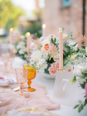 pink candles and colored glassware